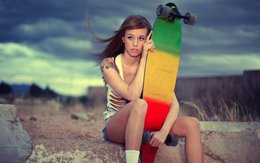 Sporty girl and skateboard 055628